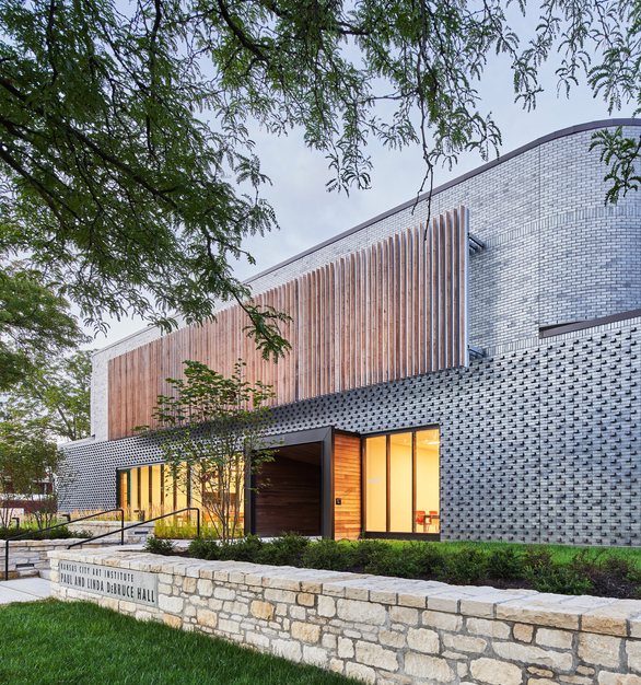 The aesthetic goal was to impact every student at the college and elevate the profile of KCAI's academic programs by designing an environmentally friendly, visually stunning facility, while maintaining design continuity with the neighboring community. The dark, rich manganese ironspot brick exterior takes its queues from the tones, textures, shapes and materials used in adjacent sites. The integration of curved bricks into the design combines a feeling of spontaneous creativity with precision and strength. Consistent with the art historians who are enshrined within the building's main portal, the high sheen iron ore additives in the brick work to mirror and interpret the beauty around them, appearing to change with the angle of the sun and the color of the sky.