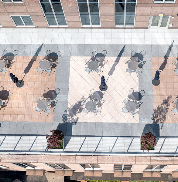 Nestled amongst the skyscrapers, EQT Plaza's 5th floor balcony was recently updated and now features architectural pavers from Wausau Tile. Creating a more usable and efficient space, our Roof Deck Pedestal System helps maximize the available space while making it safe and durable in the Pittsburgh climate. Combining several different colors, textures and paver sizes to suit the building's architectural façade, Wausau Tile's Ridgeline and Timber pavers create a distinctive design that is on display for all of the surrounding buildings.