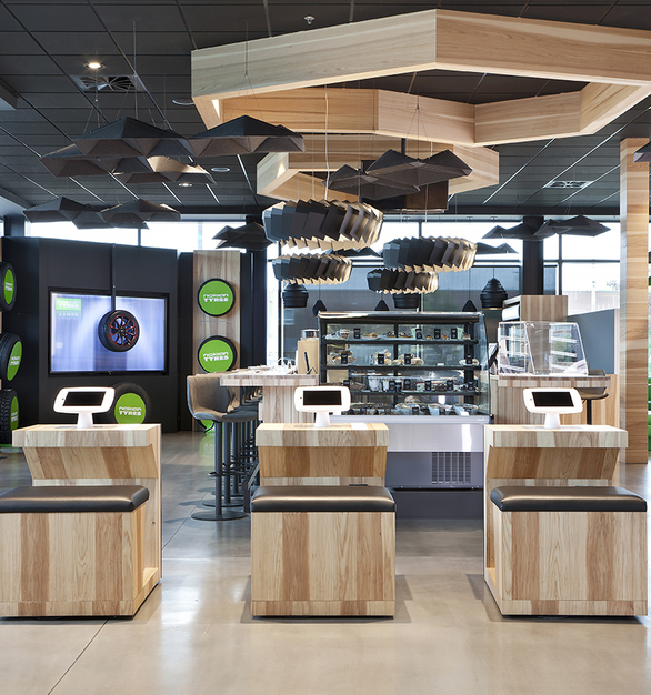 Quick check-in counter at Desharnais Pneus et Mecanique in Quebec, Canada, featuring Moto ceiling suspended lighting by Eureka.