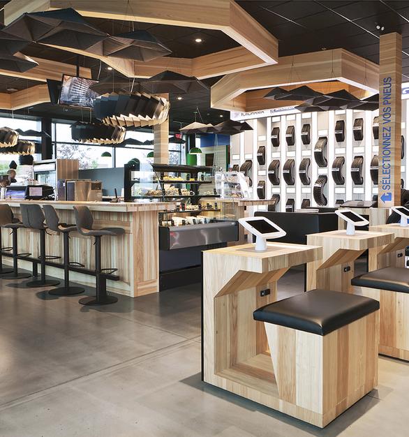 The upbeat interior design of Desharnais Pneus et Mecanique in Quebec, Canada, featuring Moto ceiling suspended lighting by Eureka.