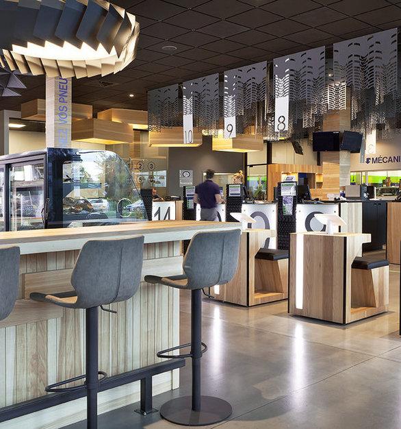 The energetic retail space of Desharnais Pneus et Mecanique, featuring the Moto ceiling suspended lighting fixture by Eureka.