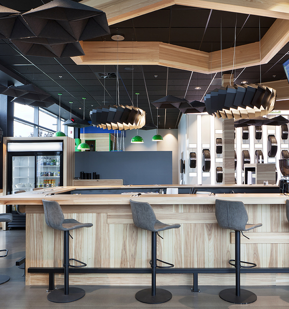 The Moto ceiling suspended lighting fixture by Eureka was used in this retail space at Desharnais Pneus et Mecanique in Quebec, Canada.
