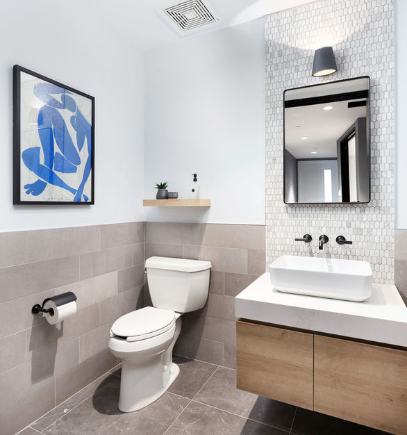 Create a modern restroom by incorporating the Eureka Slant wall surface light fixture to your interior space.