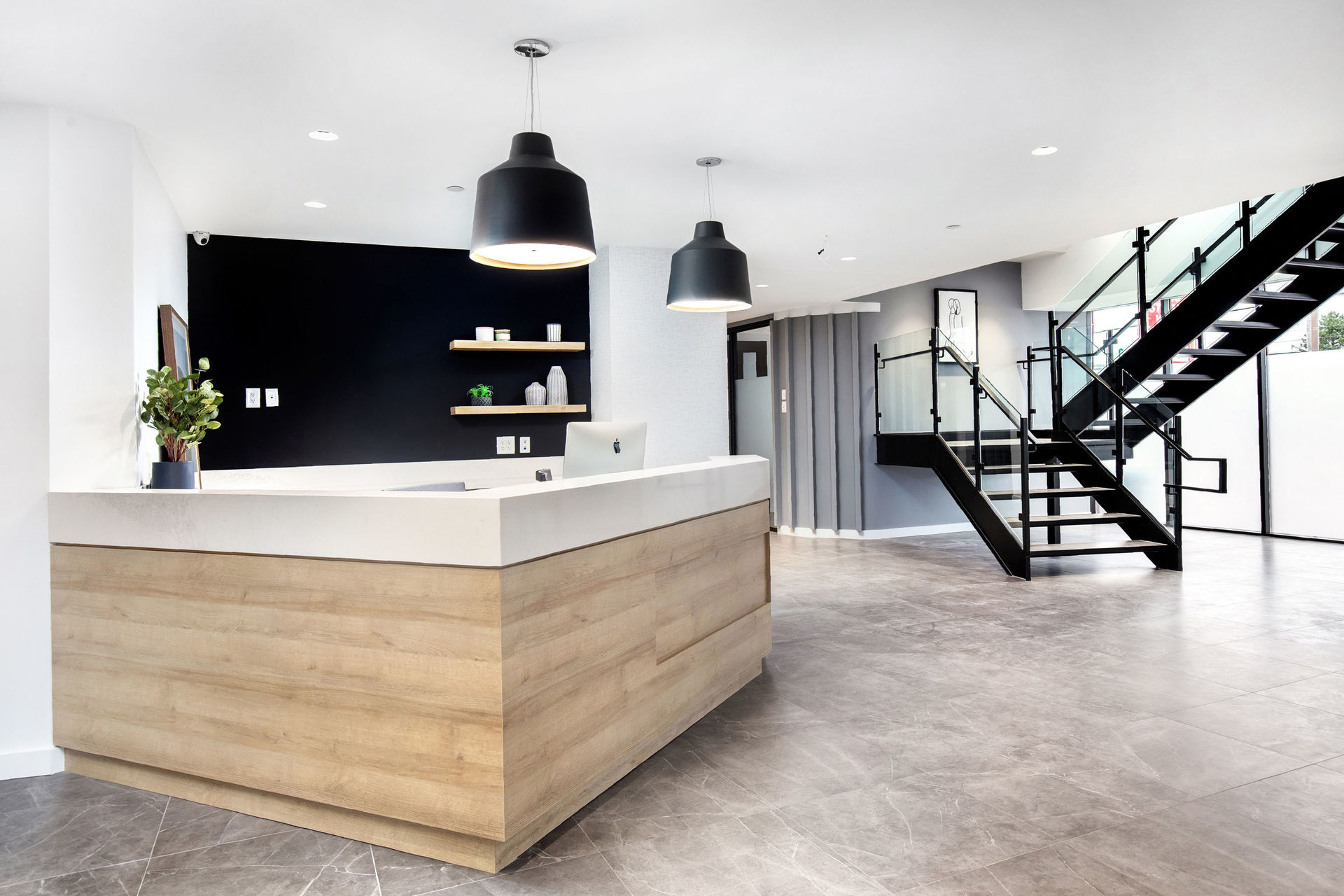 The welcoming and bright reception area at Weston Law Chambers featuring the Valco ceiling suspended lighting fixture by Eureka.