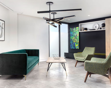 A modern waiting area at Weston Law Chambers featuring the Switch ceiling suspended lighting fixture by Eureka.