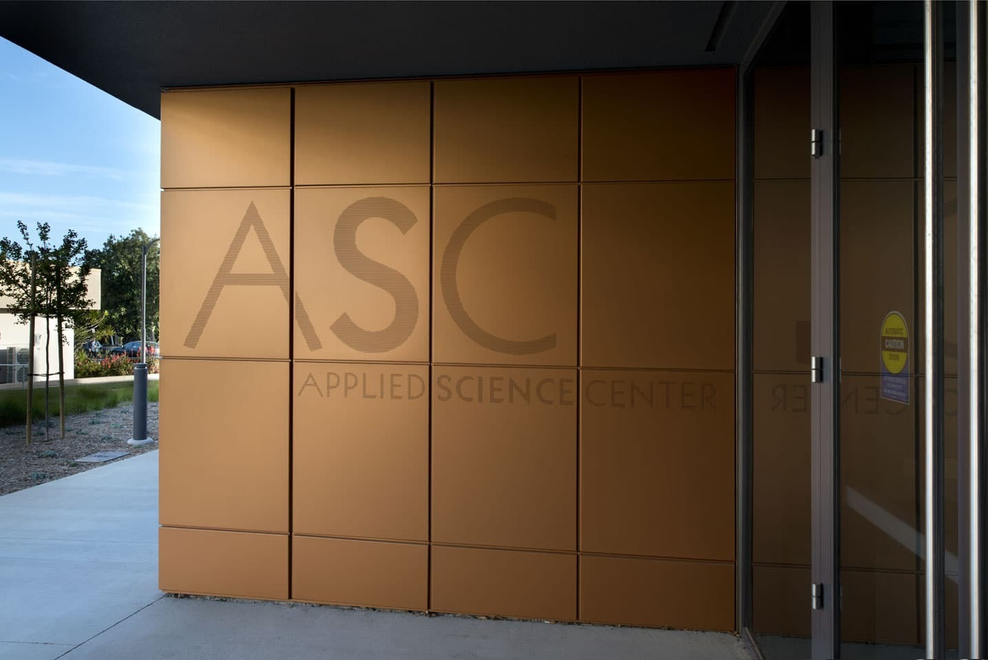 Dri-Design has many different cladding panels available.  This one allows the business to display their name on the panels.