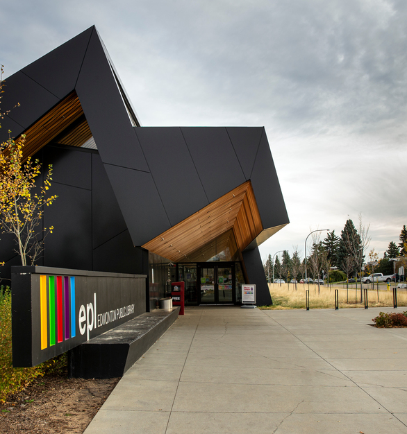 Reflecting the surrounding environment, natural wood clads the interior ceilings, interspersed with long, thin vertical lights – brightening the space. The wooden materials are also found on the exterior, at the bottom of the peaks formed from the building envelope's sharp angular design. This design is enhanced by the mix of rectangular and polygonal ALPOLIC metal panels that were installed around the library's exterior in a striking black that creates a beautiful juxtaposition set against the wood accents. ALPOLIC metal composite materials deliver excellent flatness and exceptional formability to give the library a sophisticated exterior aesthetic.  Photography Credits: Jim Dobie Photogrpahy