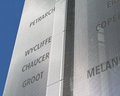 Liberty Fund's founder had created a timeline with key people, writings, and events, which provided the basis for the organization's mission. The letters etched onto the Omega 1520 became a visual 35-foot high representation of that mission, with the metal fabric cut in specific widths that represented the centuries.