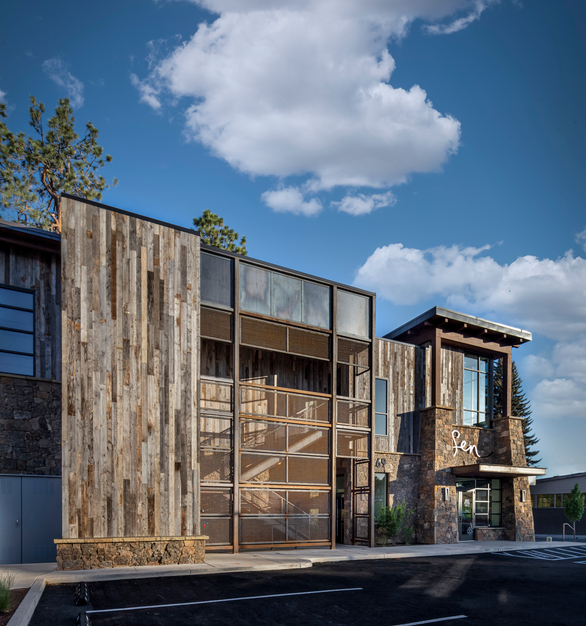This Restaurant and Office building has beautiful salvaged barn wood paneling as exterior accents from Pioneer Millworks.  Photos by Chris Murray