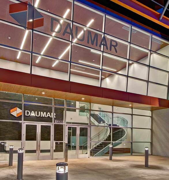 The large exterior windows at Daumar Packaging add ample natural light to the office lobby and reception space. The curving, glass staircase is also able to be seen from afar.