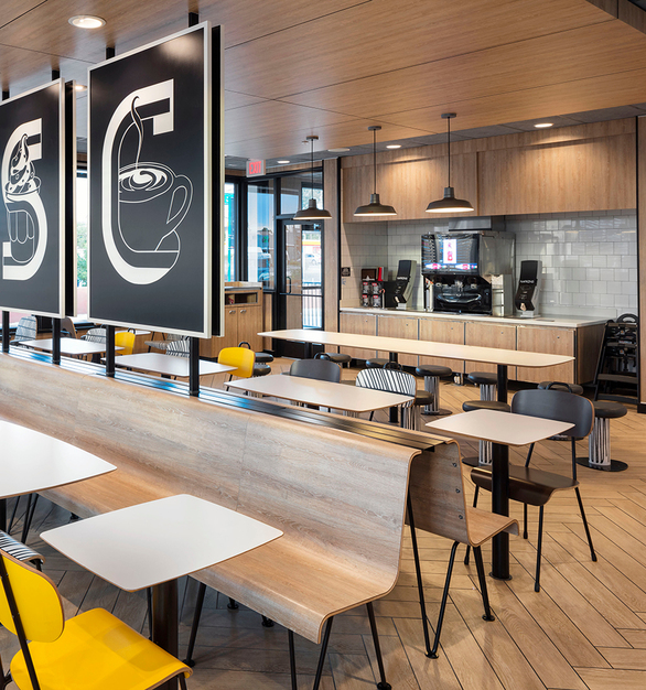 McDonald's Restaurant featuring MLU-100 with laminate panels and tile by the drink station.