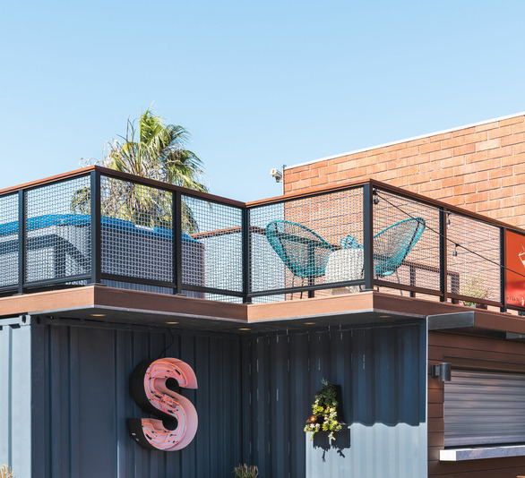Art Steedle, owner of Steedle Brothers Construction, used several of Feeney's products, including DesignRail® Panel Infill, on a container bar that he recently constructed at his company site located in the Los Angeles harbor area close to Long Beach. Art's goal with the project was to create a space at his shop where his team could unwind at the end of the day and enjoy the bar, sit in the hot tub or lawn chairs, and chat about the day.  Photography Credit: Attila Adam Photography