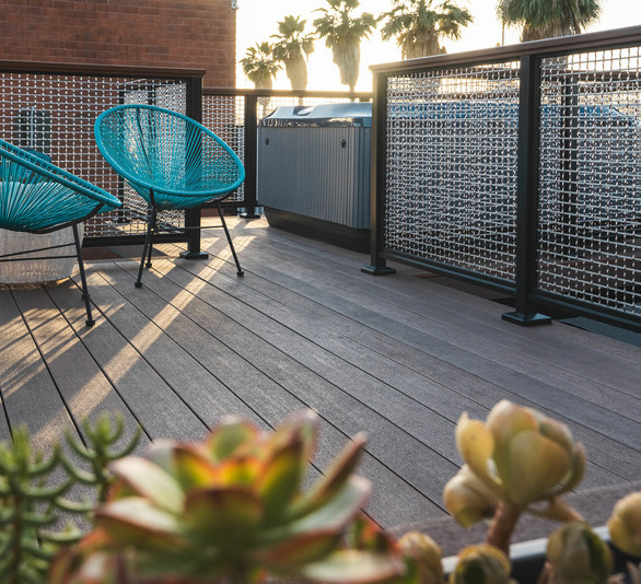 Steedle Brothers Construction opted to use Feeney's DesignRail® Panel Infill to complement the composite decking while providing a maintenance-free railing.   Photography Credit: Attila Adam Photography