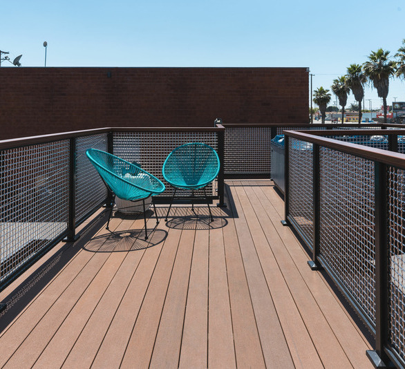 Steedle Brothers Construction opted to use Feeney's DesignRail® Panel Infill to complement the composite decking while providing a maintenance-free railing. They installed both laser cut aluminum panel Infill featuring a custom design and stainless steel mesh infill.  Photography Credit: Attila Adam Photography