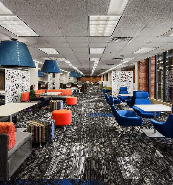 Flexible furnishings for Cowles Library at Drake University were designed in collaboration with a local furniture dealer to accommodate the varying types of study and to adapt to future phases.