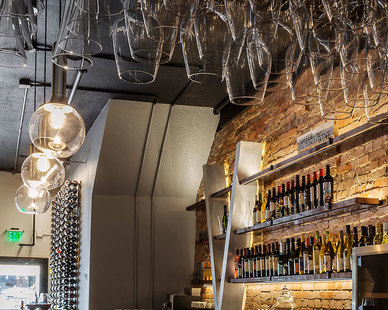 The VINO 209 Wine Bar features an authentic palette of brick, stone, steel, wood, and glass that offers a harmonizing blend of warm and cool tones. 