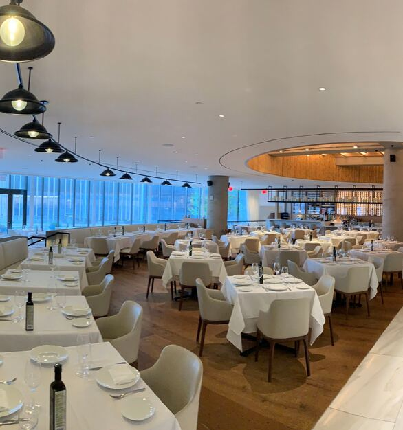 Spacious dining area showcasing Fellert's Even Better Silk acoustical plaster option. Seen here in NYC at Hudson Yard's Estiatorio Milos restaurant.