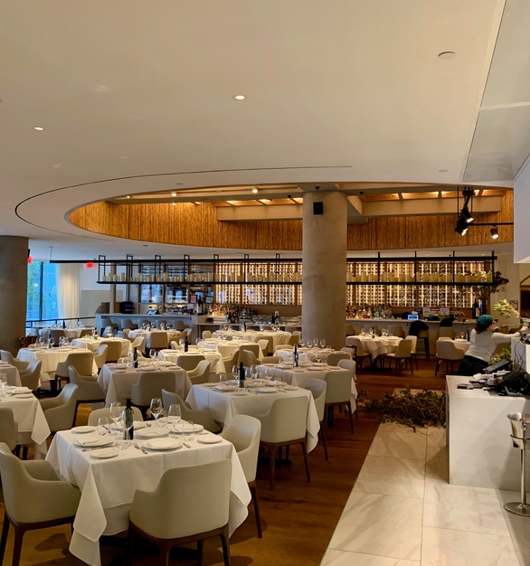Beautiful dining space at Estiatorio Milos in Hudson Yard in NYC which showcases Fellert's Even Better Silk on the ceiling to absorb sound.