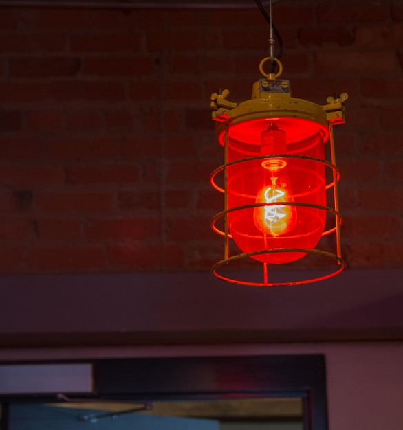These Soviet warning lights, used at pendant lighting, came out of a factory warehouse on the outskirts of Moscow and are the perfect fit for this hallway in the Five Watt Coffee Shop.