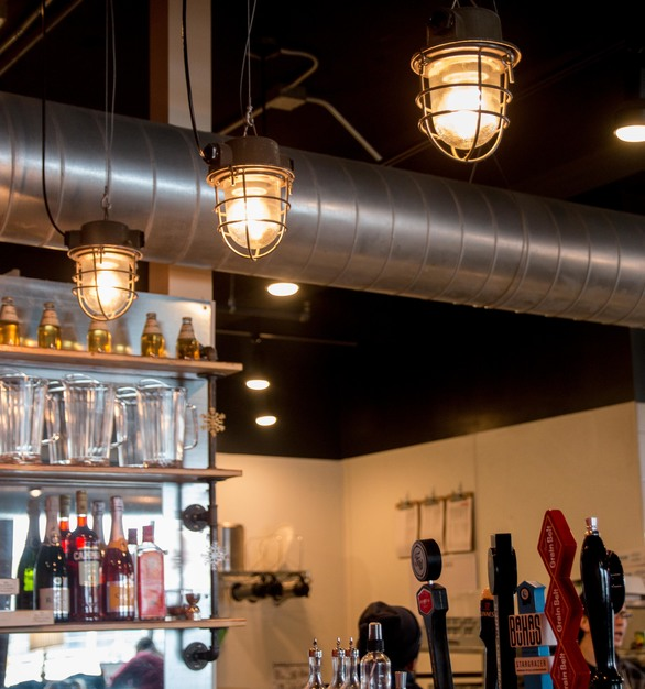 Three vintage industrial pendant lighting fixtures from FIXT Electric can be found hanging about the coffee bar area at the Five Watt Coffee Shop in Minneapolis, Minnesota.