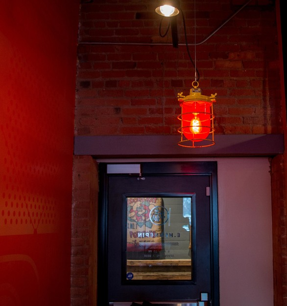 These Soviet warning lights, used as a pendant lighting, came out of a factory warehouse on the outskirts of Moscow and are the perfect fit for this hallway in the Five Watt Coffee Shop.