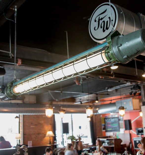 The Five Watt Coffee shop features FIXT Electric's slender, explosion proof mining fluorescent from Ukraine, The Franklin Fluorescent.
