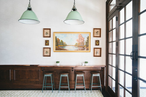 These beautiful, minimalist light fixtures were provided by FIXT electric which give a vintage look to this cafe.