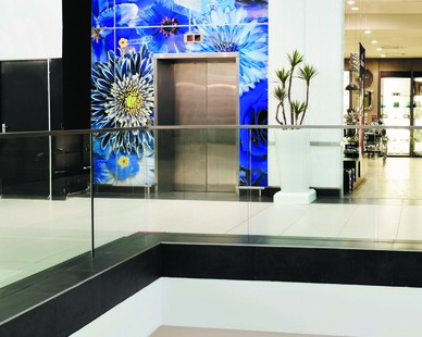 Add personalization or branding with beautiful wall graphics.  This shopping center used a floral design to create a easy way for shoppers to spot the elevators.