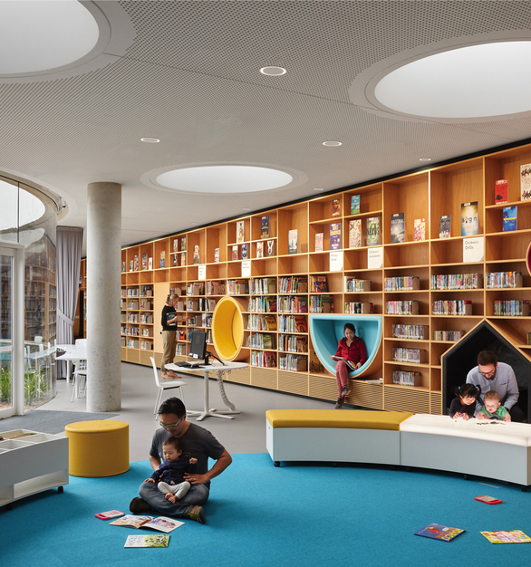 The expansive windows allow natural light to fill the children's reading area. Portal Recessed is the perfect choice for modern, functional lighting that adds to the overall design of the library space.