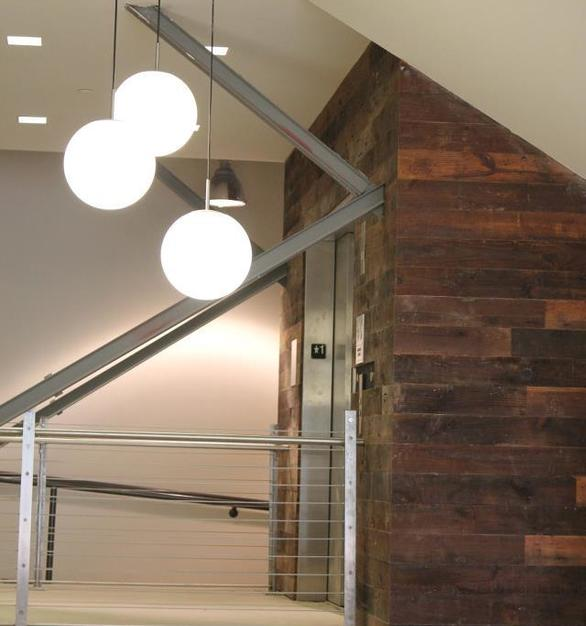 Rustic stairway at Fossil Headquarters accented with reclaimed vintage pine by Urban Woods Co.