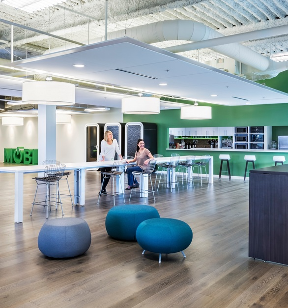 The spacious open office common area and breakroom at the MOBI offices in Zionsville, Indiana, featuring the Framery O private office pod by Framery Acoustics. Photography Susan Fleck