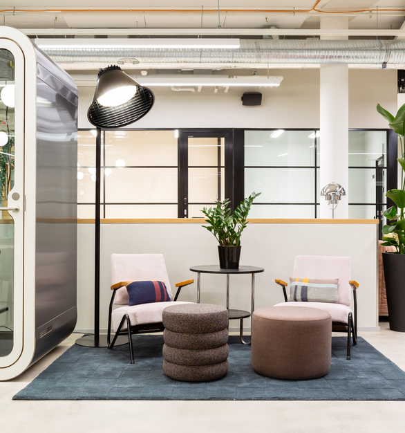 A bright office breakout space at MOW Supernova Ratina coworking space in Tampere, Finland, featuring the Framery O by Framery Acoustics. Photography by Esa Kapila