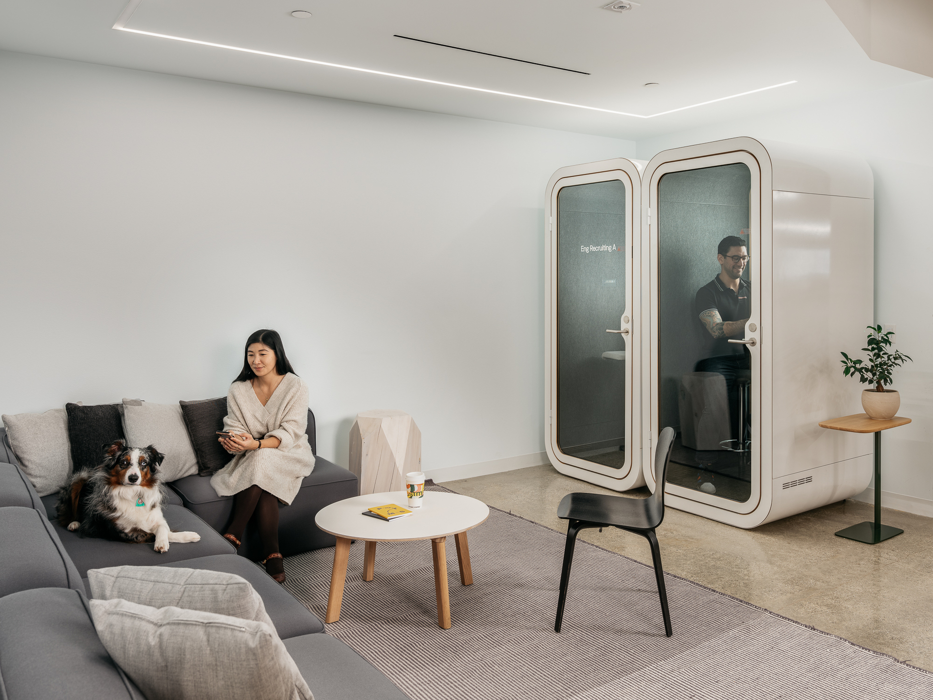 A comfortable office space at Postmates San Francisco, featuring two Framery O's by Framery Acoustics.