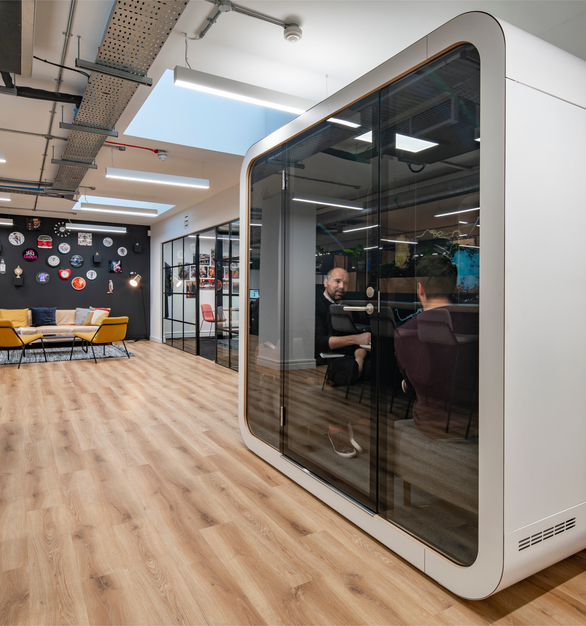 Peldon Rose designed the new Total Media offices in London by creating an open concept workplace design and called on Framery to provide their Framery Q office pods for private meetings and important conversations. Photography by Stephen Bennett
