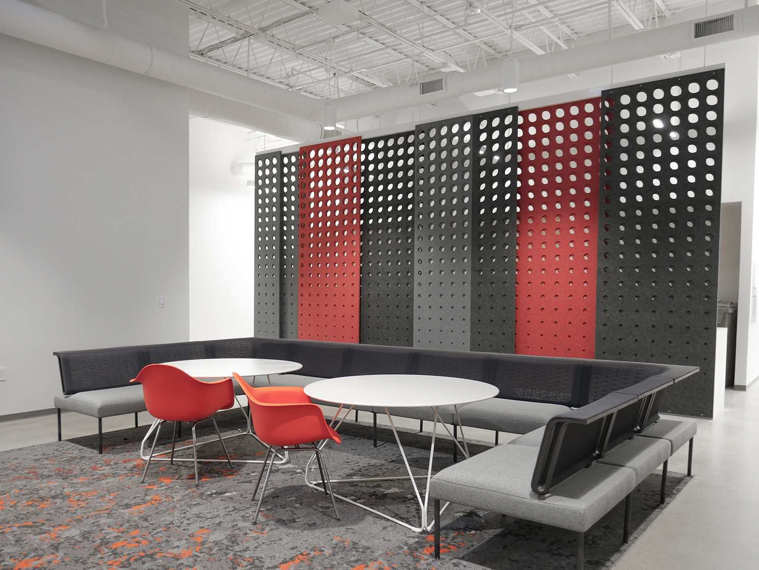 A work lounge can be somewhat distracting but with PANL, Fräsch's acoustical laser-cut divider screens you can have an office lounge or open work space without any disruption.