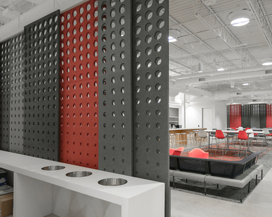A large, open office workspace can be easily and efficiently divided using Fräsch PANL acoustical laser-cut divider screens to minimize space while also provided privacy.