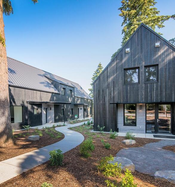 Exterior Wood Siding is featured in this building in too colors Designed & Built by: Green Hammer Photographer: 22 Pages Photography