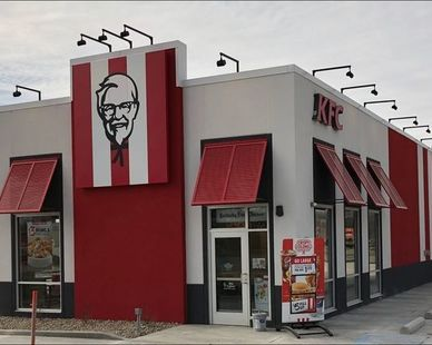 Fullerton Building Systems provided its panelized building system with factory-applied exterior finishes to the Kentucky Fried Chicken franchise in Burton, Michigan (KBP Foods).
