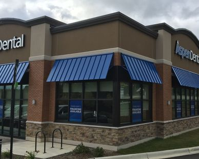 The exterior of Aspen Dental is shown here as a part of the strip mall by Launch Properties. Fullerton Building Systems provided the BrickWal, Stone and Nichiha exterior finish.