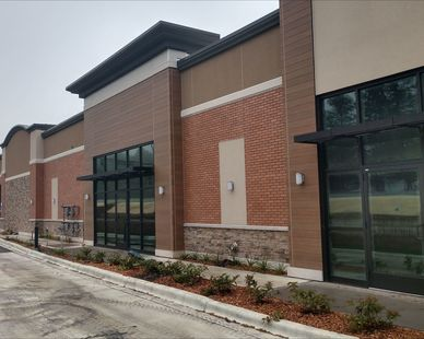 Shown here is the backside of a strip mall by Launch Properties. You can see the Fullerton Building Systems products used such as BrickWal, Stone and Nichiha exterior finish.