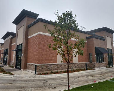 Shown here is the drive-through, which will eventually be for the retailer Starbucks, which uses Fullerton Building Systems BrickWal, Stone and Nichiha exterior finish.