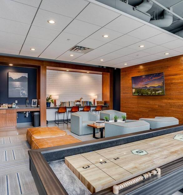 Fuse is the go-to for impeccable design. Seen here pieces from Stylex and Ethnicraft to complete this community space at The Grove apartments in St. Paul, Minnesota.