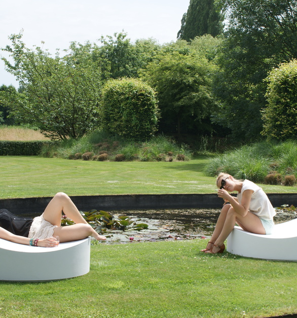 Beautiful garden is accented with lounge chairs by SIXINCH.