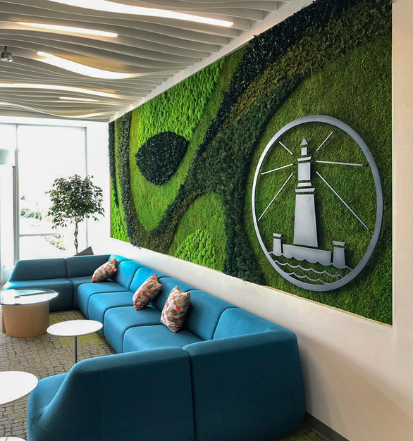 Garden walls can incorporate company logos for creative design. This application features Eucalyptus, Forest, and Fern species over a Flat Moss canvas.