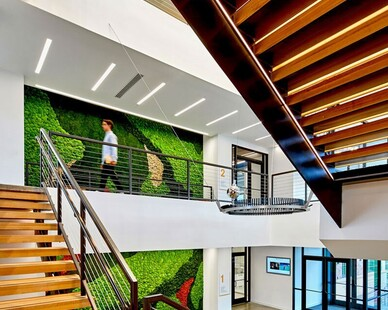 The main lobby at Chaminade High School's Dolan Family Science, Technology, and Research Center, features a 38-foot multi-panel installation of all-natural preserved plants. These maintenance-free nature installations provide a unique design to any interior space.