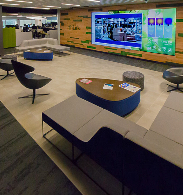 """The open meeting space features a large media wall with wood wall accents and Moss species preserved plants. With an average depth of 3"""" for vertical applications, integrating The Art of Preserved Nature® is as simple as adding a picture frame – essentially creating framed art to the biophilic design canvas."""