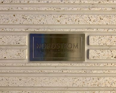 The precast concrete with an integrated plaque sign at the Nordstrom store in The Woodland, TX.