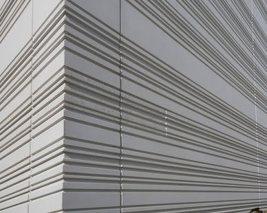 Close-up detail and design of the storefront exterior featuring architectural precast concrete by Gate Precast.