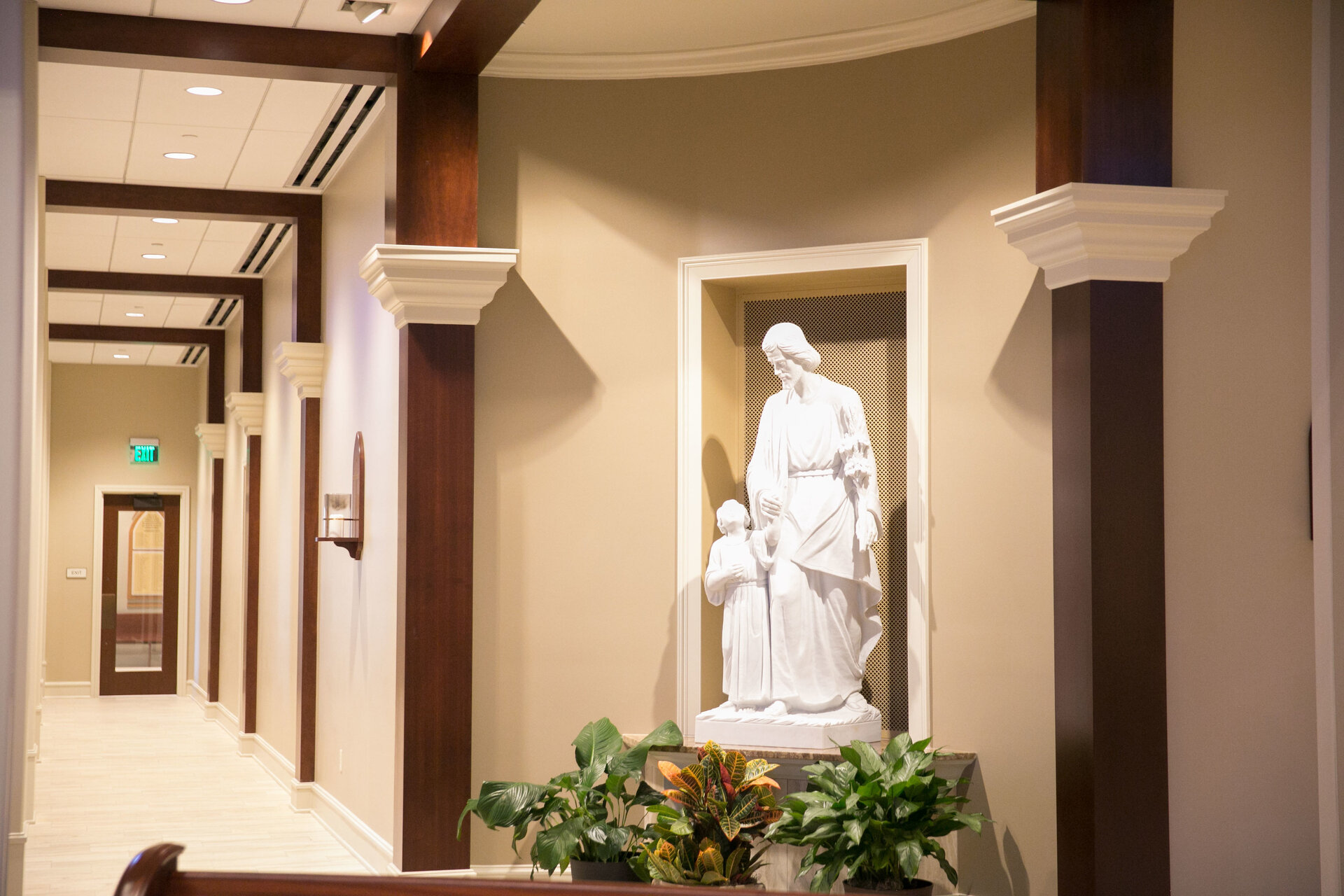 Detailed work provides a seamless and clean design at St. George Catholic Church in Baton Rouge, Louisiana. Gator Millworks developed the decorative trim, arches and the stained millwork pieces throughout the space.