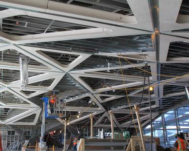 By producing detailed shop drawings, GC Products produced a faceted custom ceiling that saved framing and manpower and installed quickly.